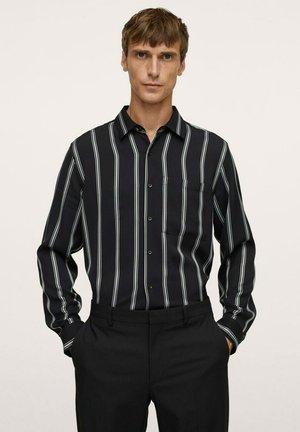 FLIESSENDES  - Shirt - schwarz