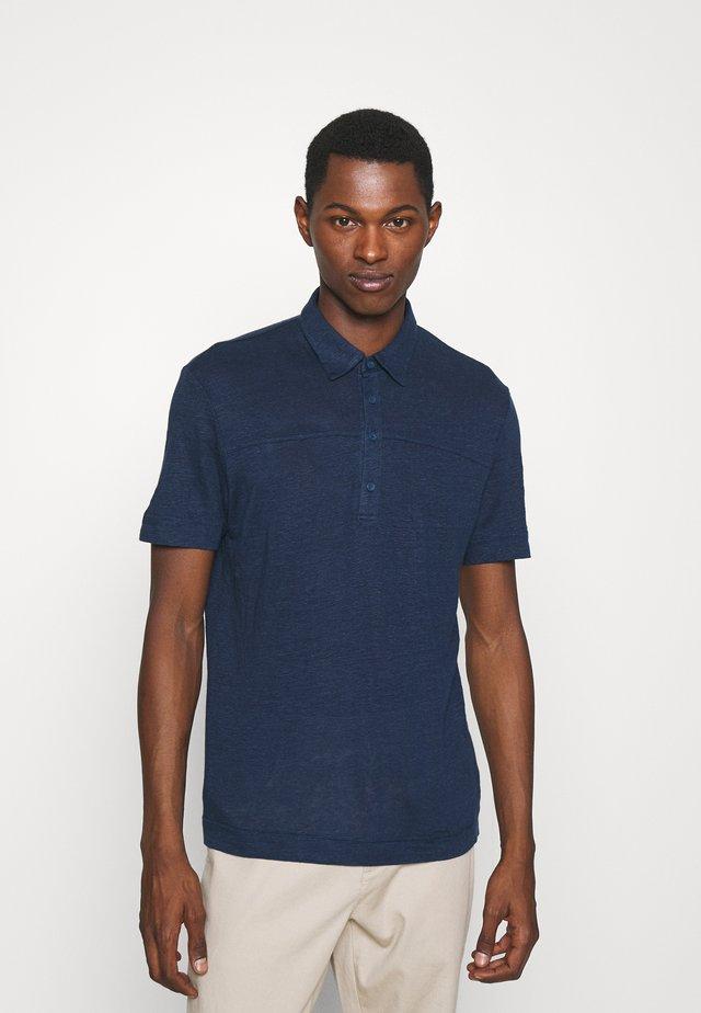 POPOVER - Polo shirt - blue