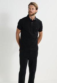 Tommy Hilfiger - PERFORMANCE REGULAR FIT - Polo - black - 0