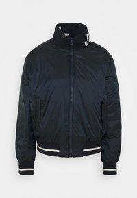 J.LINDEBERG - MALOU PADDED GOLF JACKET - Outdoor jacket - navy - 0