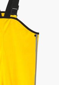 Reima - LAMMIKKO - Rain trousers - yellow - 4