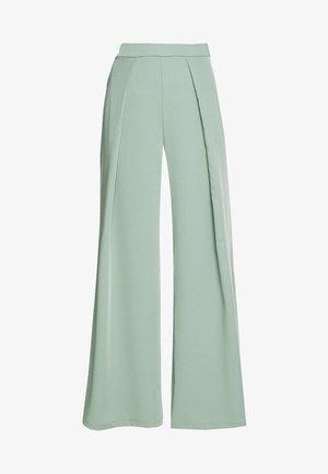 GLAMOROUS STUDIO - Trousers - green