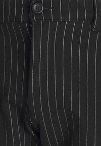 Denim Project - PLUS PONTE ROMA PLAN - Trousers - black/white - 4