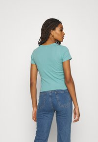BDG Urban Outfitters - NEW WAVE SUNSHNE BABY TEE - Print T-shirt - turquoise - 2