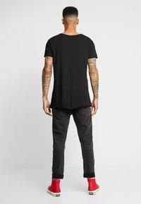 Urban Classics - T-shirt med print - black - 2