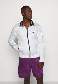 Calvin Klein Jeans - ZIP UP HARRINGTON - Summer jacket - bright white - 0