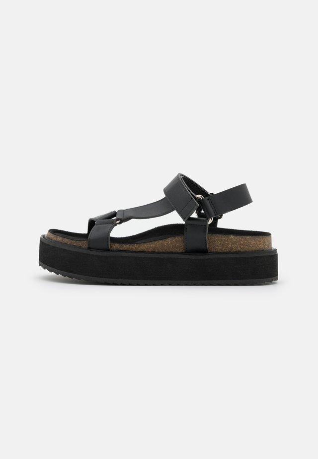 KYRA - Korkeakorkoiset sandaalit - black
