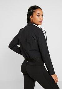 Reebok - ELEMENTS TRAINING TRACKSUIT - Dres - black - 2