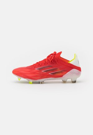 X SPEEDFLOW.1 FG - Moulded stud football boots - red/core black/solar red