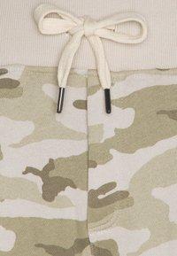 Schott - PHIL COMBAT - Tracksuit bottoms - desert beige - 2