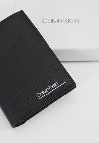 Calvin Klein - SLIVERED COIN - Monedero - black - 2