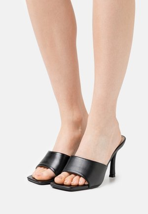 BRIYA - Heeled mules - black