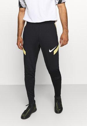 STRIKE PANT  - Spodnie treningowe - black/saturn gold/white