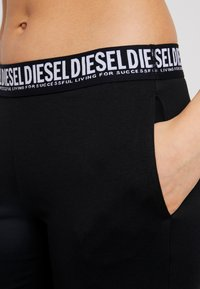 Diesel - UFLB-BABYX TROUSERS - Pyjama bottoms - black - 4