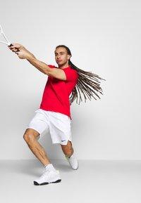 Nike Performance - Sports shorts - white/black - 3