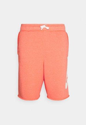 ALUMNI - Tracksuit bottoms - turf orange