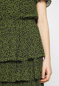 MICHAEL Michael Kors - MINI TIER DRESS - Day dress - black/evergreen - 5