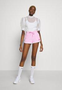 Nike Sportswear - Tracksuit bottoms - pink - 1
