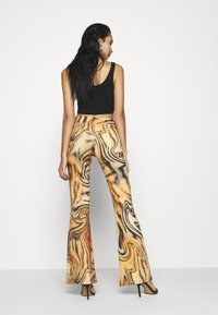 Jaded London - FRONT BOOTCUT TROUSER TIGER SWIRL - Pantalones - multi - 2