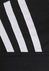 adidas Performance - BRA - Medium support sports bra - black/white - 4