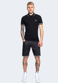 Calvin Klein Jeans - Denim shorts - black - 1