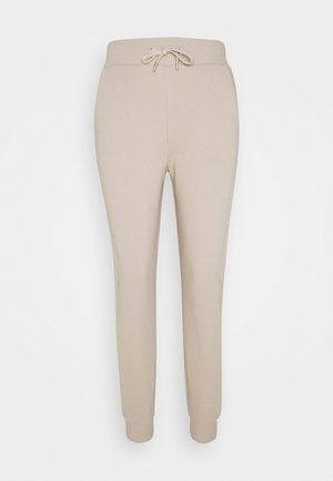 FIT - Tracksuit bottoms - beige