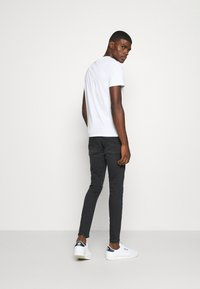 11 DEGREES - ABRASION SUPER SKINNY - Slim fit jeans - black - 2