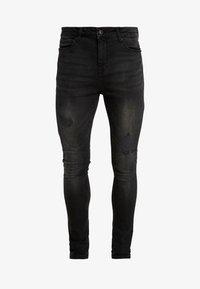 STAN SUPER SKINNY - Jeans Skinny Fit - black