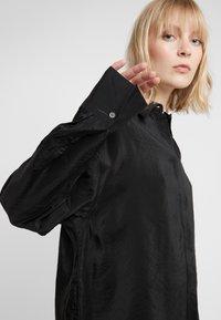 Filippa K - TECH - Button-down blouse - black - 4