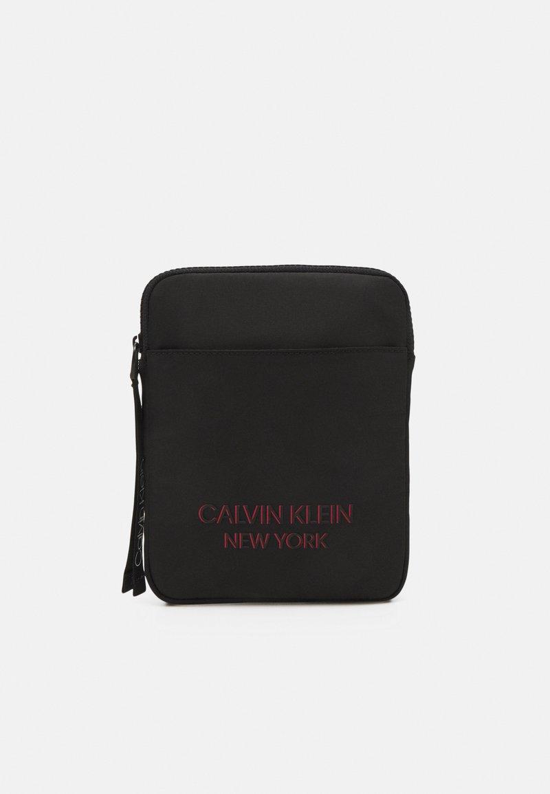 Calvin Klein - FLAT PACK UNISEX - Across body bag - black