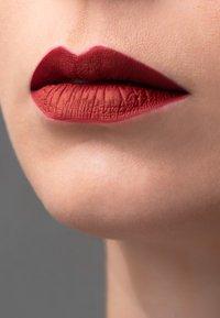 Korres - MORELLO MATTE LASTING LIP FLUID - Liquid lipstick - 59 brick red - 1