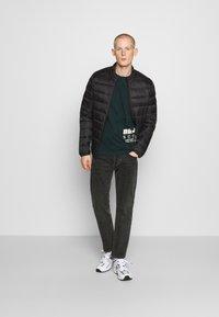 Jack & Jones - JJEMAGIC PUFFER COLLAR  - Light jacket - black - 1