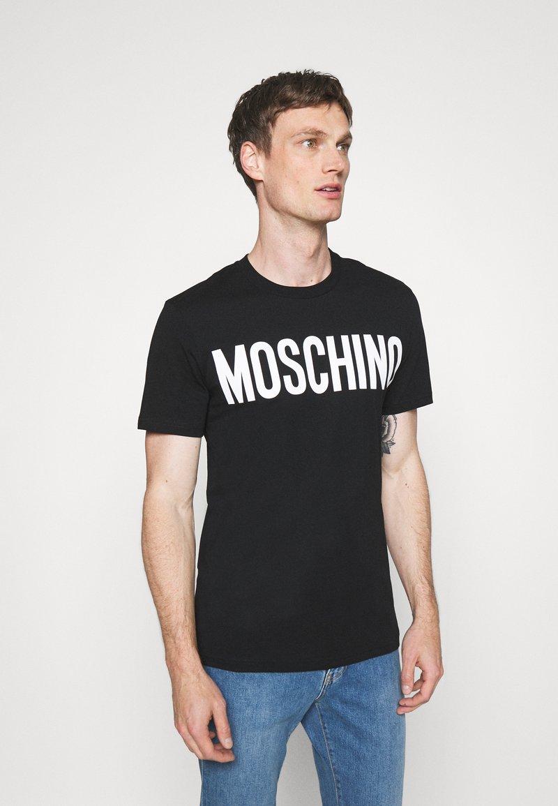 MOSCHINO - Camiseta estampada - black