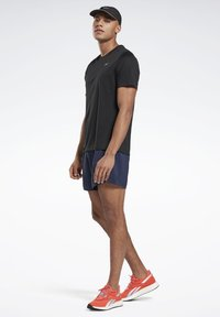 Reebok - NIGHT RUN SHIRT - T-shirt basic - black - 1