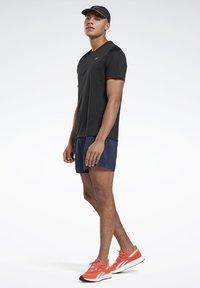 Reebok - ESSENTIALS SPEEDWICK RUNNING - T-shirts basic - black - 1