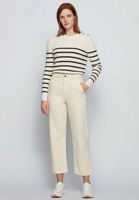 BOSS - Straight leg jeans - open white - 1