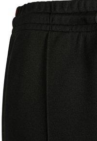 Urban Classics - DAMEN LADIES SIDE TAPED TRACK PANTS - Pantalones deportivos - black - 5