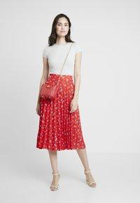 Dorothy Perkins - PLEATED SKIRT - A-line skirt - red - 1