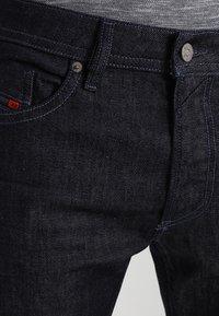 Diesel - THOMMER-X - Slim fit jeans - blue-black - 3