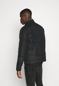 Calvin Klein - QUILTED JACKET - Light jacket - black - 2