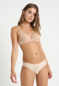 Triumph - LOVELY  - Multiway / Strapless bra - smooth skin - 1