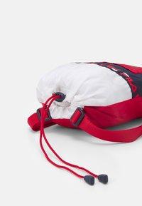 Fila - SOFT DRAWSTRING BACKPACK UNISEX - Sports bag - black iris/true red/bright white - 3