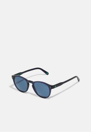 UNISEX - Sunglasses - shiny transparent blue