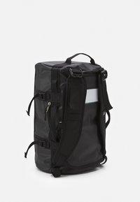 The North Face - BASE CAMP DUFFEL XS UNISEX - Hiking rucksack - black/white - 1