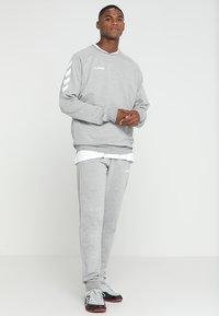 Hummel - HMLGO COTTON PANT - Spodnie treningowe - grey melange - 1
