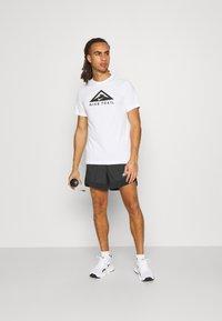 Nike Performance - TRAIL - Shorts outdoor - black/dark smoke grey/white - 1