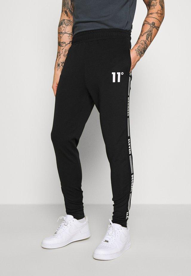 TAPED TRACK PANTS - Spodnie treningowe - black