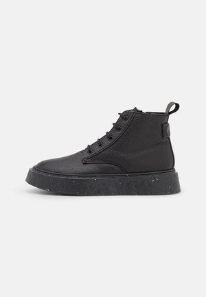 Ankle boot - elefante/nero