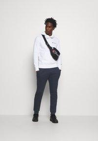 Champion - LEGACY CUFF PANTS - Teplákové kalhoty - dark blue - 1