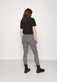Calvin Klein Jeans - MILANO LOGO  - Leggings - Trousers - institutional black - 2